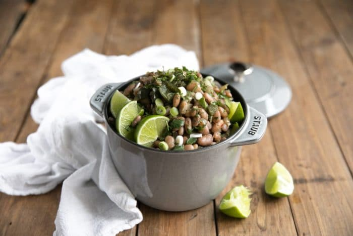 A fun and flavorful twist on boring bland beans, these easy Drunken Beans with Poblanos taste fantastic eaten alone or paired with all your favorite Mexican dishes.