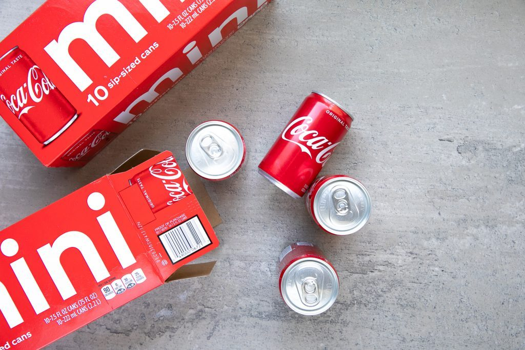 Coke cans on table
