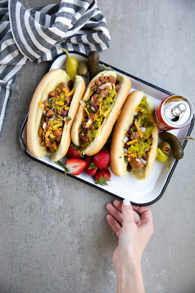 Easy Instant Pot Coca-Cola Chili and Sausage Dogs. Hearty beef chili cooked in the Instant Pot under 30 minutes. Serve at your next bbq alongside a full sausage dog bar!
