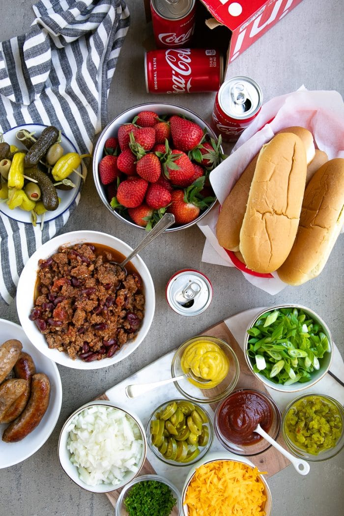 Coke Chili and Sausage Dog Bar with cheese, mustard, onions, relish, strawberries