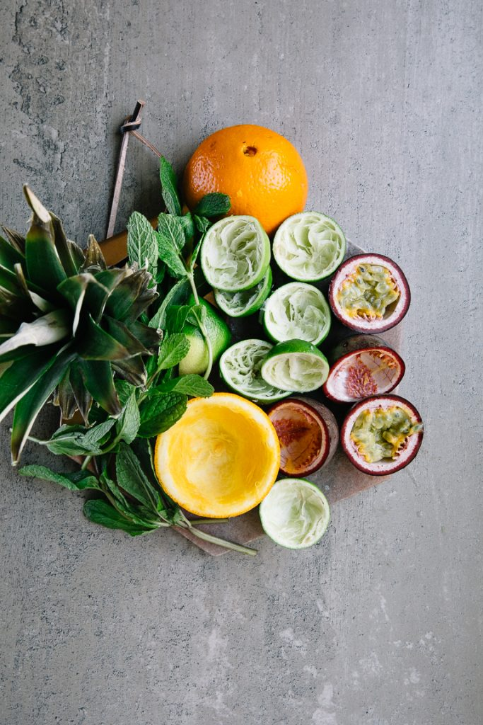 Picture of oranges, passion fruit, pineapple, limes, lemon