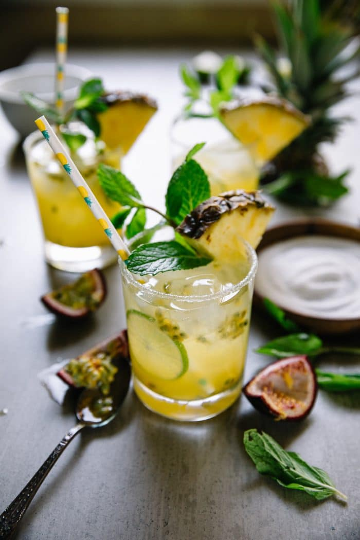 passion fruit sparkling margarita with pineapple straw