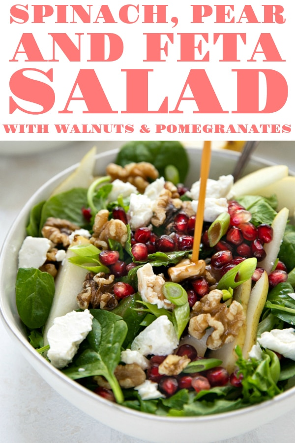 Spinach, Pear, and Feta Salad with Walnuts and Pomegranate Arils. Ready in just 5 minutes, this salad is easy, delicious, and perfectly suited for any holiday or occasion. Sprinkled with sweet pomegranate arils and earthy walnuts, this salad is the perfect combination of sweet,tangy, and crunchy #salad #pomegranatearils #sidesalad #glutenfree #healthyrecipe #pearsalad #lowcarb #fetacheese | For this recipe and more visit, https://theforkedspoon.com