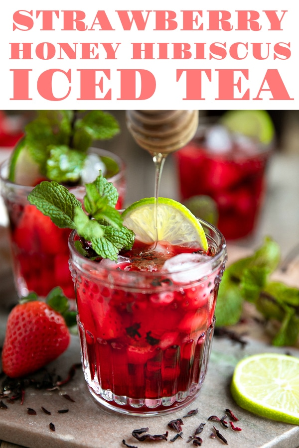 Strawberry Honey Hibiscus Iced Tea. Wildly popular thanks to unique health benefits and appearance in Starbucks shops all over the world, this Strawberry Honey Hibiscus Iced Tea is sweet, energizing, and beautiful via @theforkedspoon #icedtea #sweettea #hibiscus #honeytea #summer #beverages #rearecipe #icedtearecipe #easyrecipe | For this recipe and more visit, https://www.theforkedspoon.com