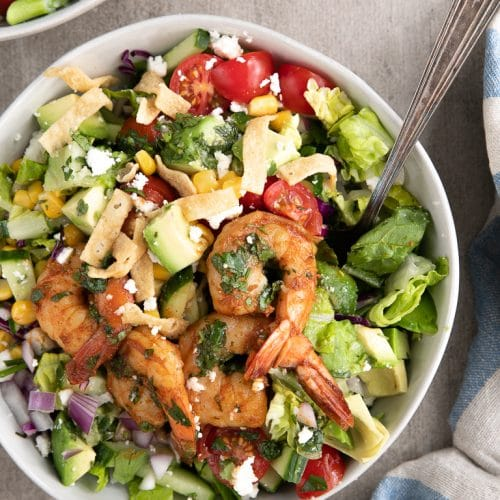 A bowl of chopped salad with Shrimp