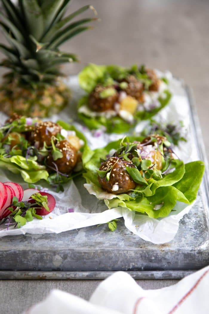 Hawaiian Meatballs Lettuce Wraps with Pineapple on a Baking tray