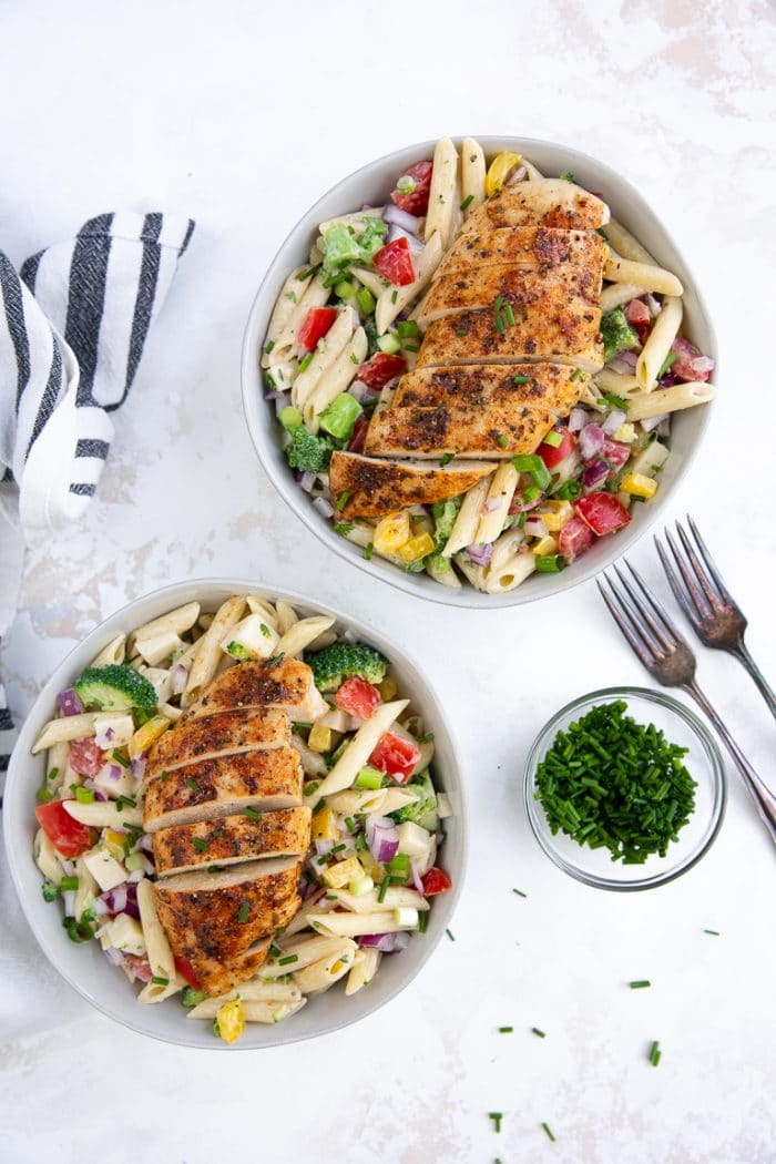 Cold pasta salad with creamy ranch dressing and topped with ranch chicken breasts
