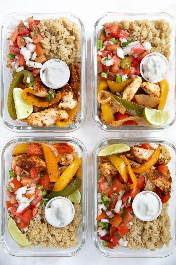 Chicken Fajita meal prep bowls with quinoa, pico de gallo and sour cream