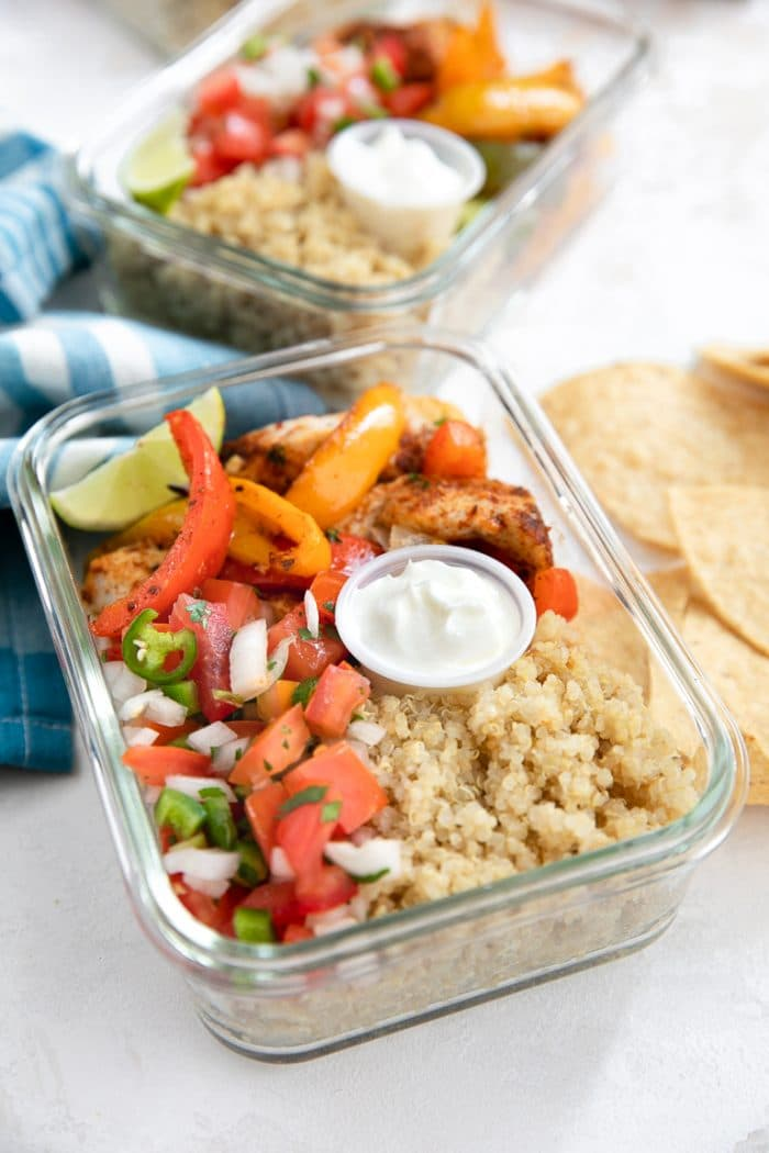 individual meal prep container with chicken fajitas and quinoa