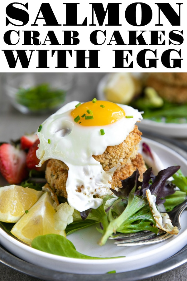 Salmon Crab Cakes with Fried Egg. A delicious, uncomplicated, and protein-filled meal. Easily turn this Salmon Crab Cake Recipe into a complete meal by serving alongside a fresh green salad, rice, and fried egg. #crab #crabcakes #salmon #salmonrecipe #salmoncrabcakes #easyrecipe #seafood #friedegg #eggs #dinnerideas | For this recipe and more visit, https://theforkedspoon.com