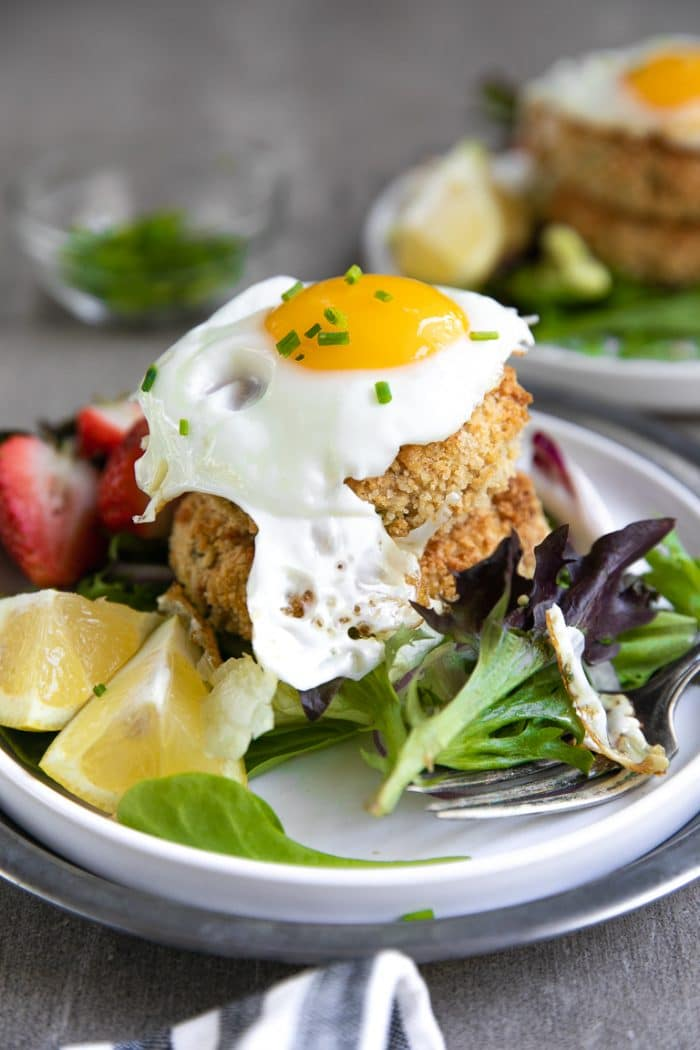 salmon crab cakes topped with a fried egg