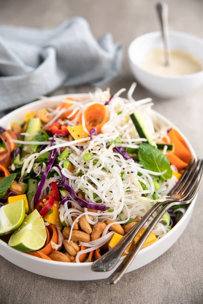Large white bowl filled white Cold Thai Noodle Salad