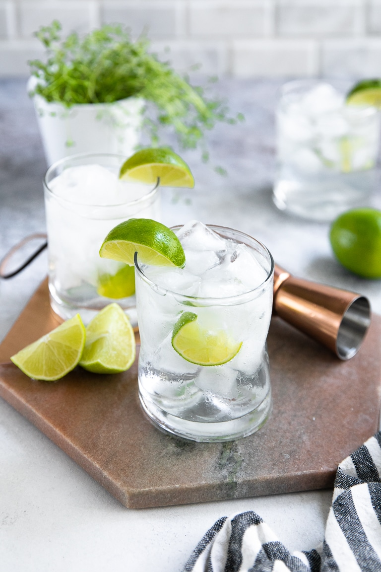 Three gin and tonic cocktails on the rocks