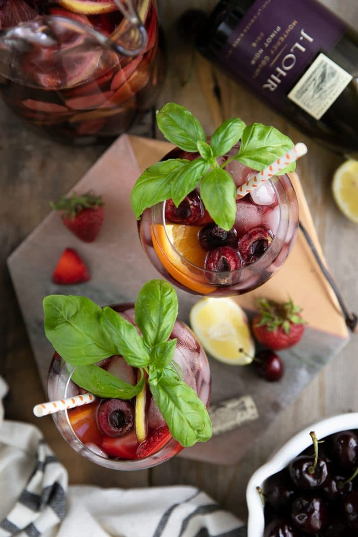Glasses filled with cherry strawberry lemonade sangria