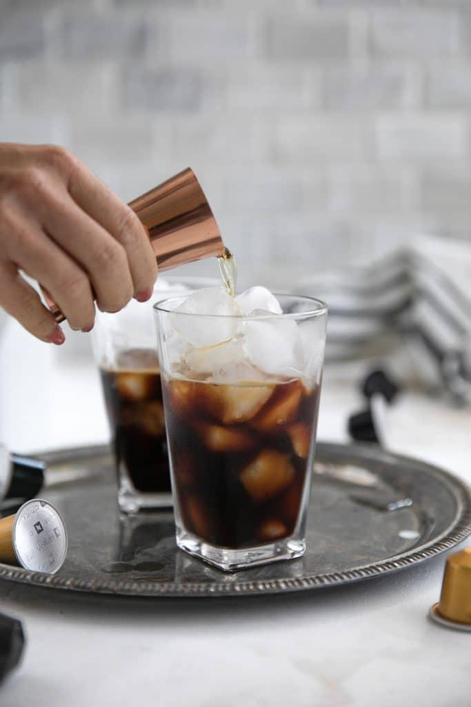 pouring whiskey into espresso