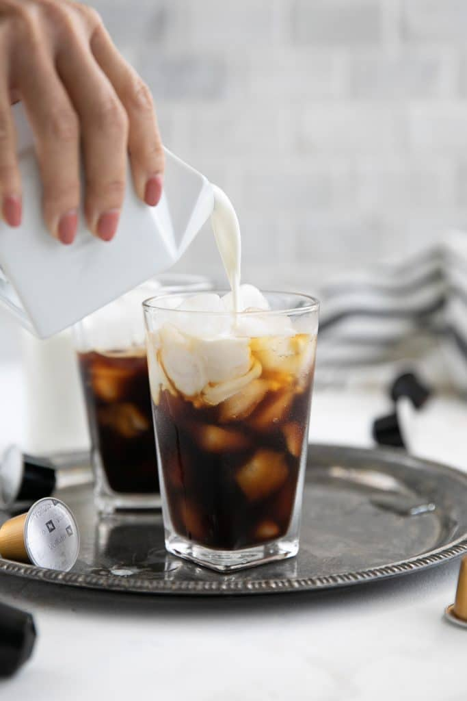 pouring cream into irish iced coffee