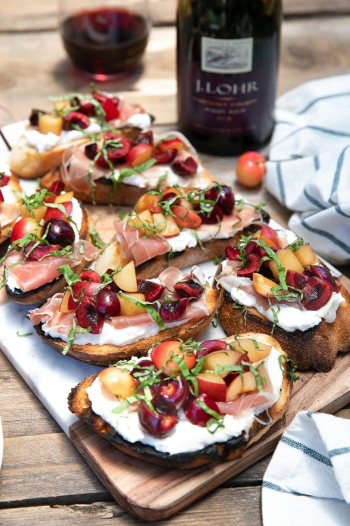 Cherry, Plum, and Prosciutto Bruschetta with Whipped Goat Cheese and Ricotta