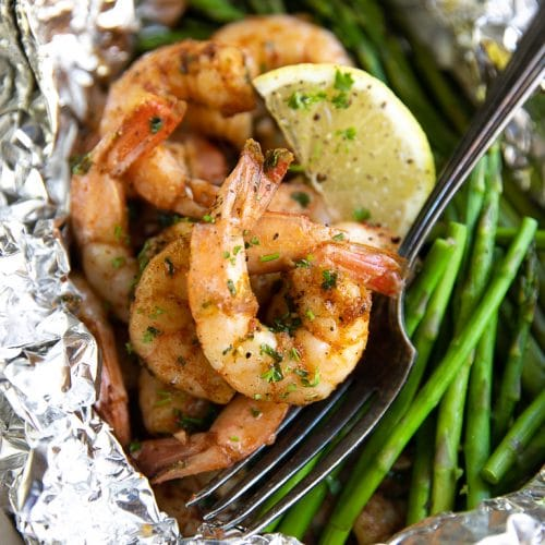 A close up of cajun shrimp in foil Packet