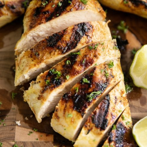 Sliced Citrus Chicken breast on cutting board