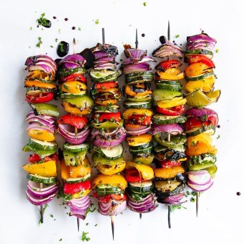 six veggie skewers in a row