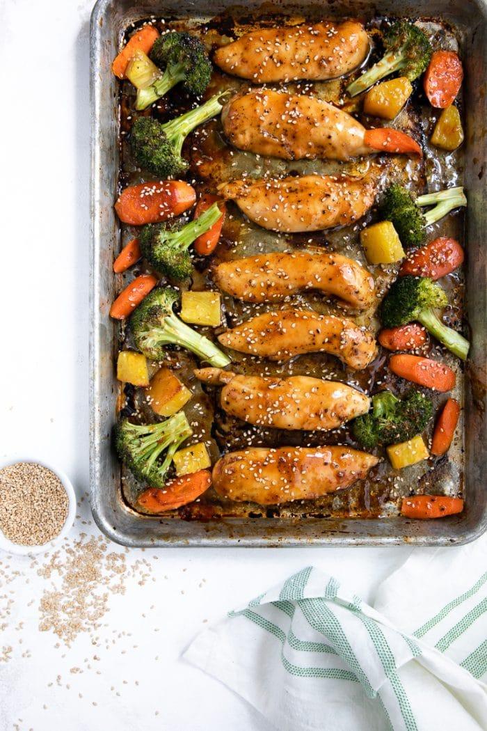 Sheet pan chicken teriyaki tenders with roasted broccoli, carrots, and pineapple