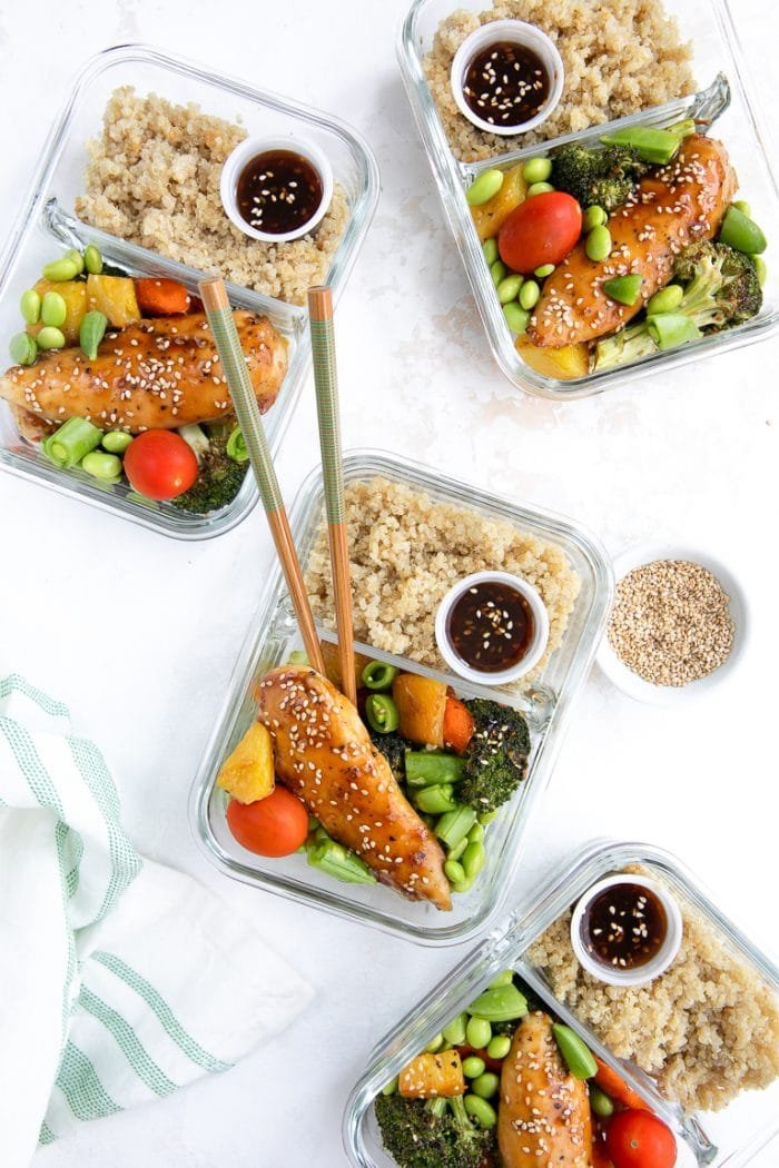 Four chicken teriyaki meal prep bowls with roasted veggies and quinoa