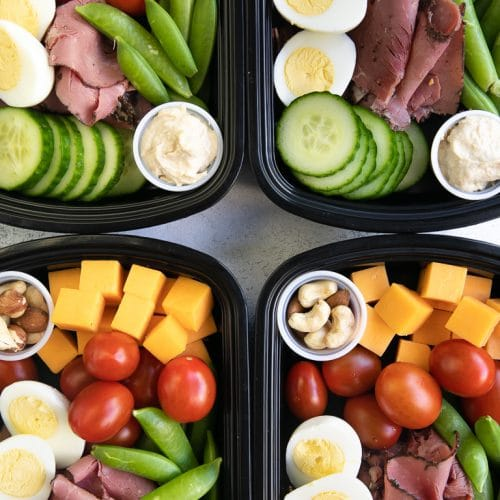 A bunch of protein foods with veggies in a meal prep container