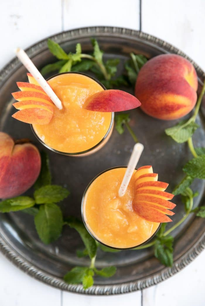 Overhead image of two peach wine slushies
