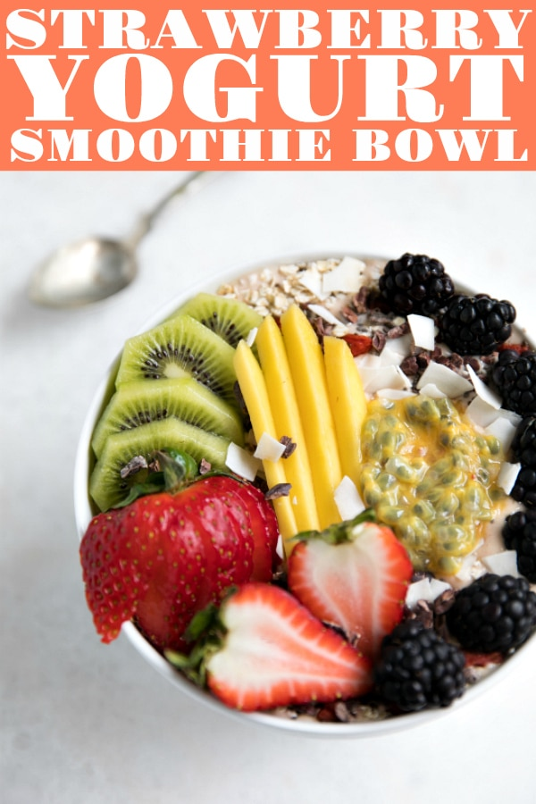 Easy Strawberry Yogurt Smoothie Bowl Recipe is made with a handful of simple ingredients like frozen strawberries, oats, chia seeds, and yogurt and takes just 5 minutes to make. Continue reading for all my tips and tricks on how to make the very best, extra thick, smoothie bowl #smoothiebowl #yogurtsmoothie #easyrecipe #vegetarian #acaibowl | For this recipe and more visit, https://theforkedspoon.com