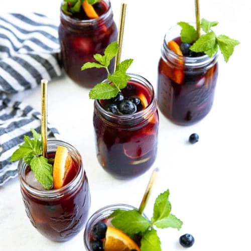 four jars filled with Blueberry Sangria