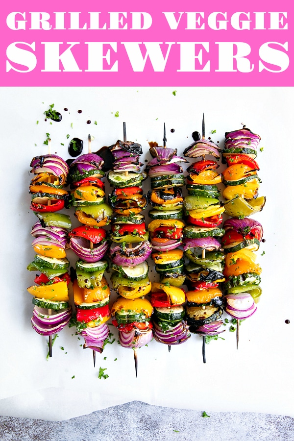 Grilled Veggie Skewers perfectly charred, drizzled with tangy balsamic vinegar and brushed with a fresh garlic herb sauce. #vegetarian #vegan #vegetarianrecipe #healthyrecipe #summerrecipes #veggieskewers #vegetableskewers #bestvegetablestogrill #easyrecipe | For this recipe and more visit, https://theforkedspoon.com