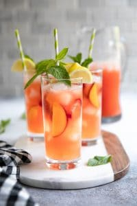 A close up of glasses filled with Peach strawberry Lemonade