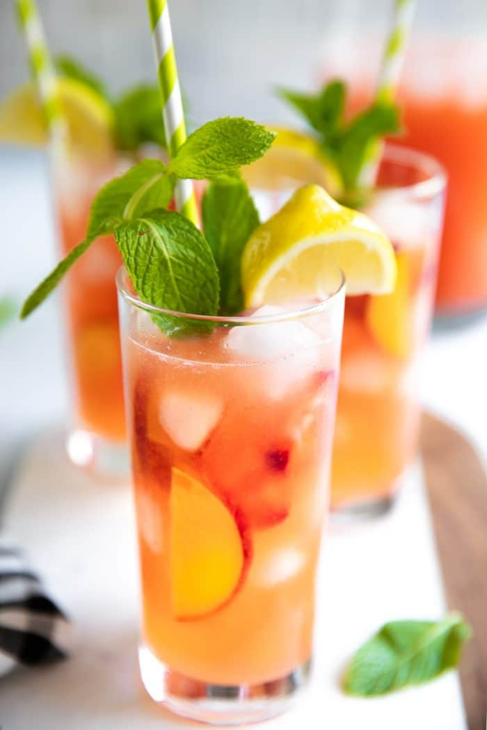 Homemade peach and strawberry lemonade with mint