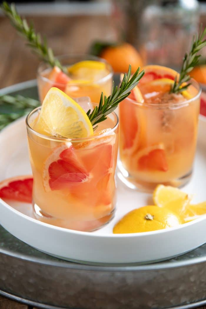 close up image of whiskey grapefruit cocktail with rosemary
