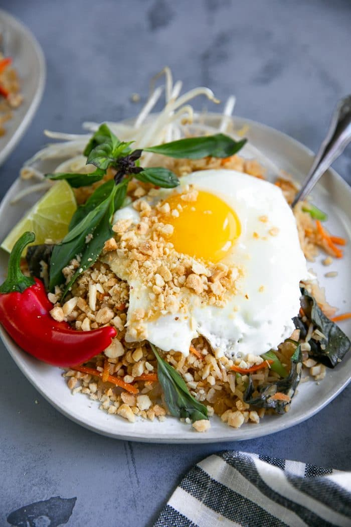 Plate filled with Thai Fried Rice and a Fried Egg on Top