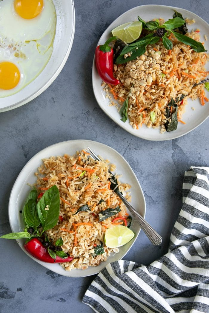 Plates filled with Thai fried rice with Thai basil