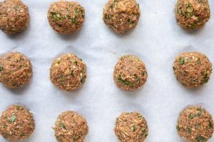 A close up of many uncooked Meatball