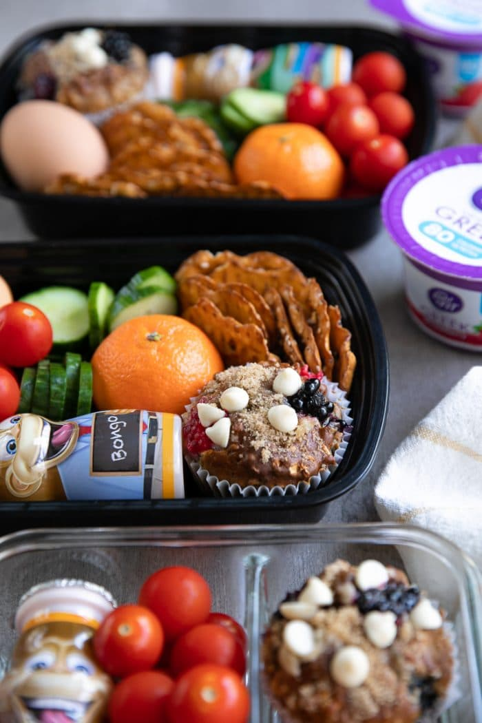 Back to school snack packs filled with homemade muffins, fruit, yogurt, and fresh veggies.