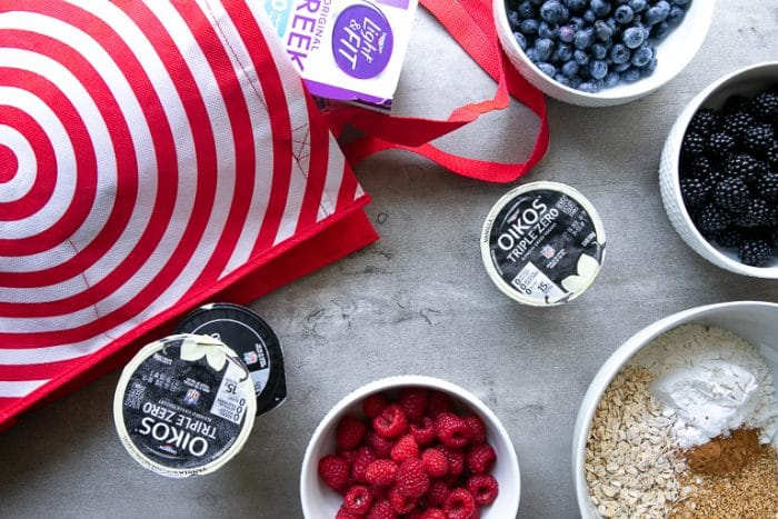 Target shopping bag and Oikos Greek Yogurt with bowls filled with fresh berries