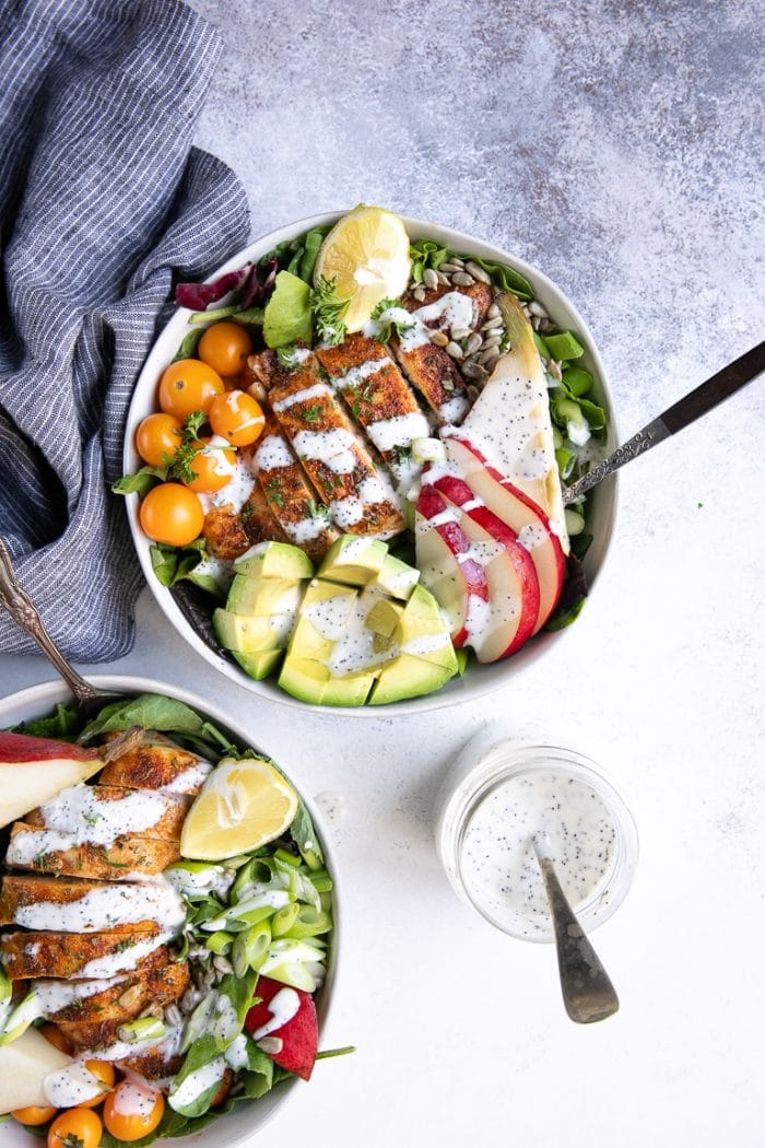 Overhead image of prepared and styled salad bowls filled with Autumn Chicken and Pear Salad with Poppyseed Dressing