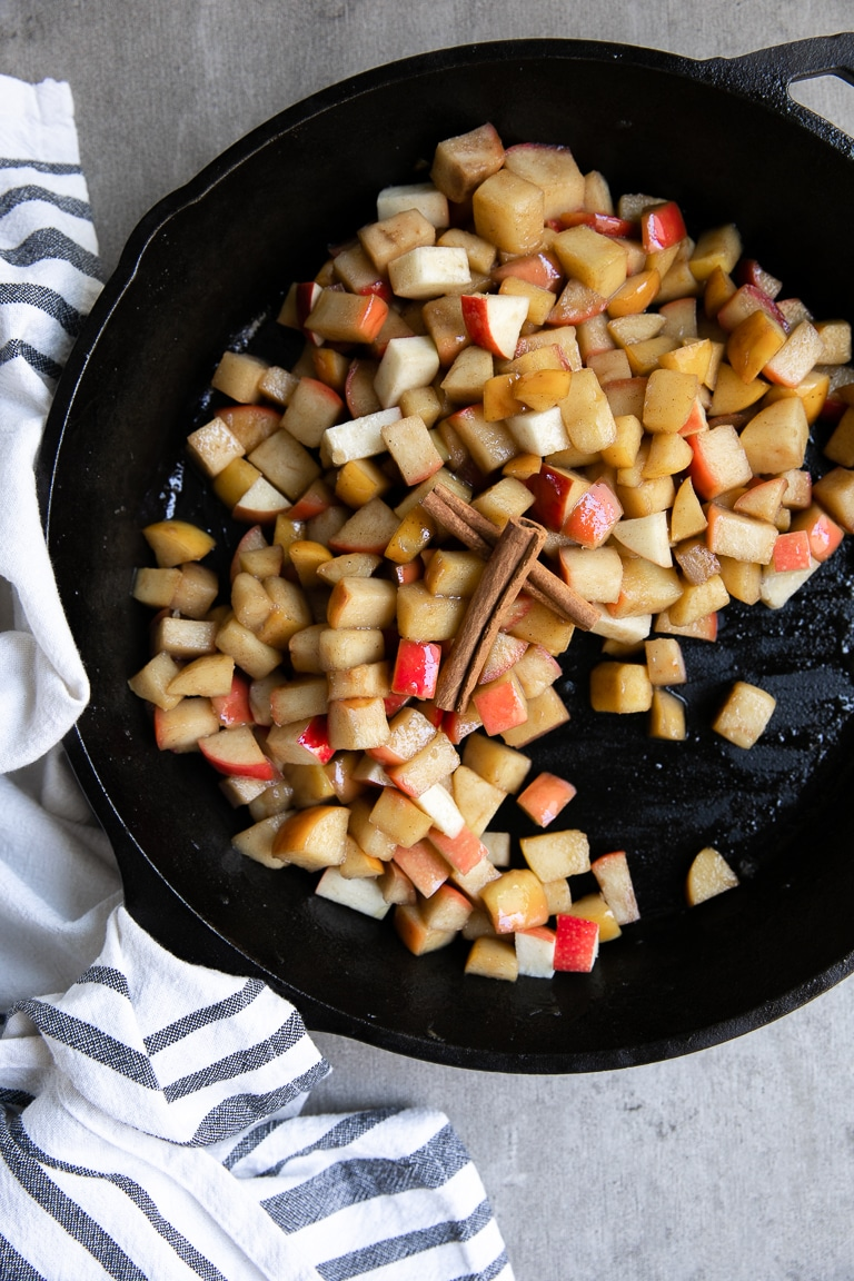 Apples chopped into cubes and fried in a large cast-iron skillet with butter, cinnamon and sugar.
