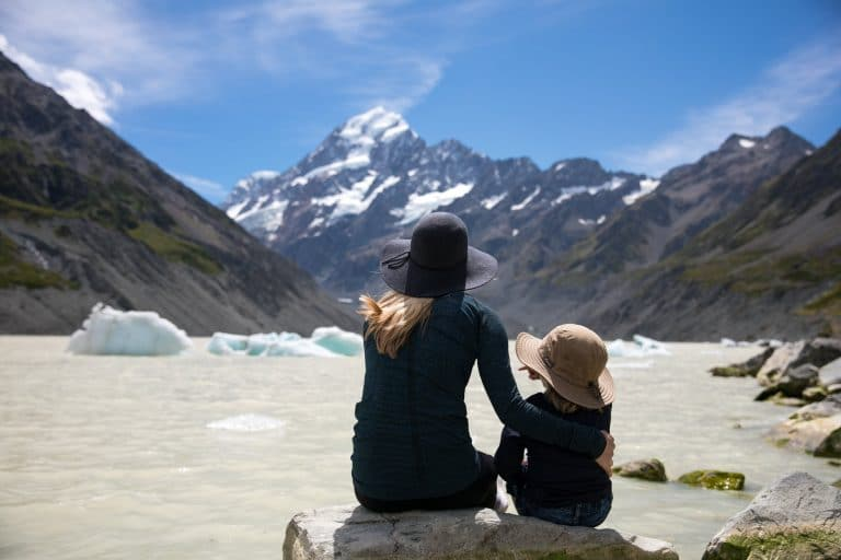 Jessica and her son at glacial lake near mt cook in New Zealand