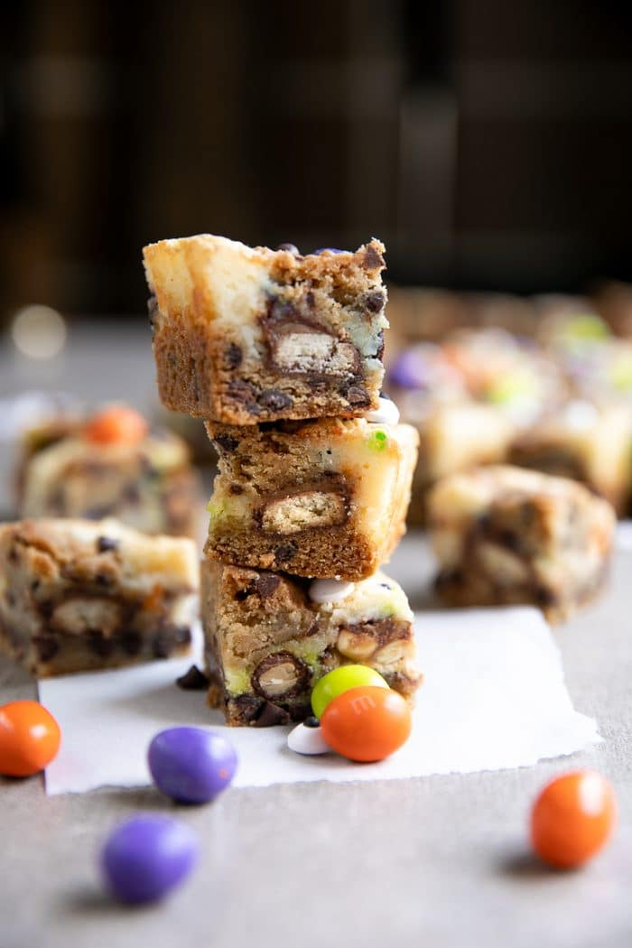 Cut and stacked Candy Bar Halloween Chocolate Chip Cookie Cheesecake Bars