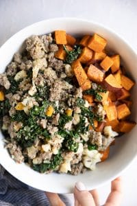 A plate of ingredients for sweet potato sausage casserole