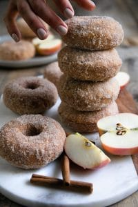 A close up of baked apple doughnuts