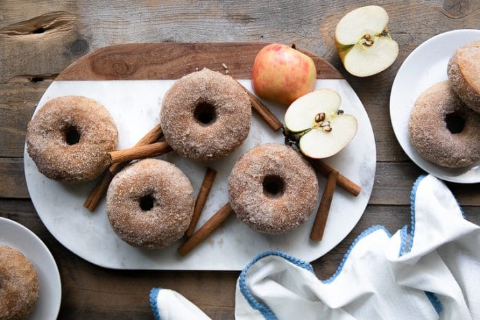 Cinnamon Sugar Baked Apple Donuts on a platter