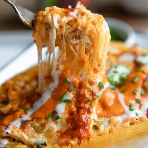 A close up of a Buffalo Chicken Stuffed Spaghetti Squash