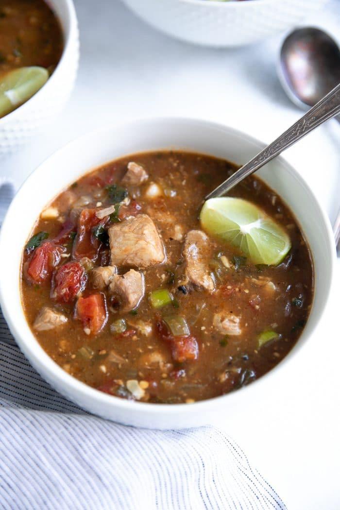 White bowl filled with Instant Pot Pork Green Chili Stew