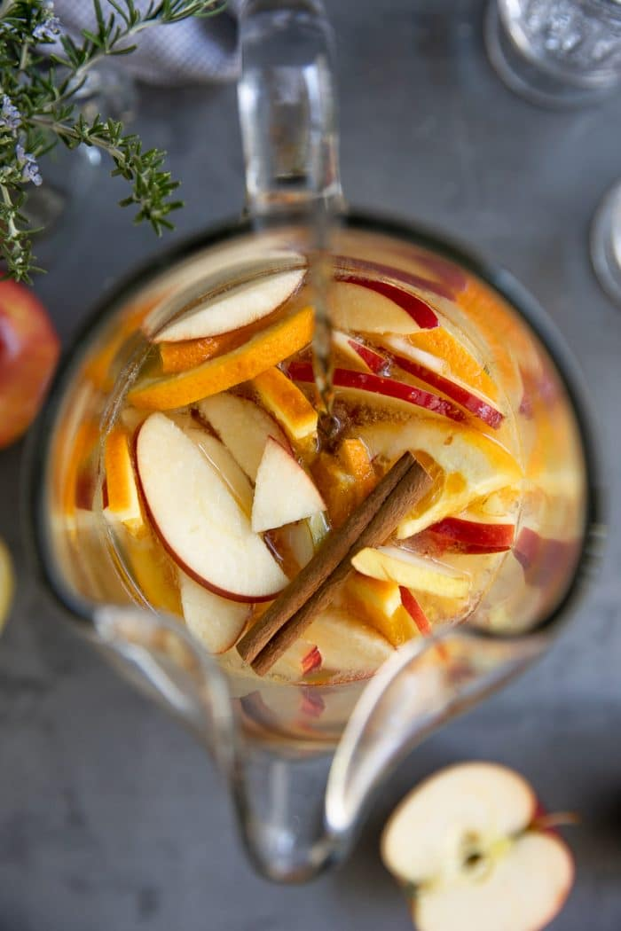 Overhead look into a pitcher filled with fall sangria