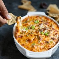 Baked Buffalo Chicken Dip Cheese Pull with a tortilla chip.